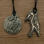 Cranes in bronze. Styled in a Celtic style and drawn by my friend Dru (complete Iron Age living history nut!) Large crane is 50mm high and 5mm thick, Small crane is 35mm high and 4mm thick  £10 in bronze with either a split ring or neck cord