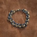 "The rings are aluminium, so this is a very lightweight bracelet. Measures 8"" when opened out, the rings are 10mm diameter"