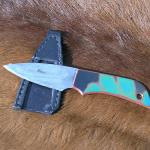 ground and polished O1 carbon steel blade with thermochromic laminate handle. Bascally, the handle changes colur when it gets warm!