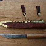 Saxon broken backed seax with metalled horizontal sheath. Forged finished blade