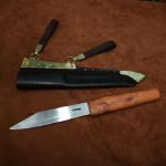 Saxon broken backed seax with metalled horizontal sheath. Polished blade